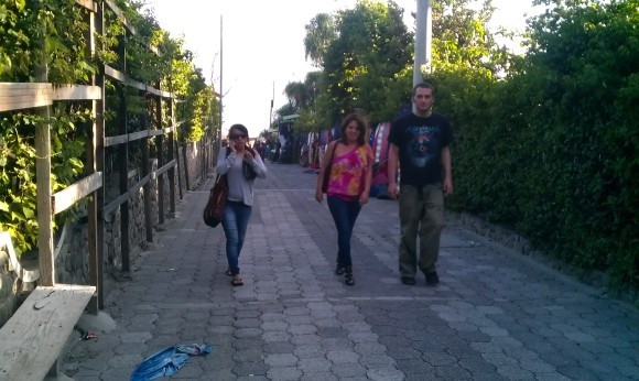 Katterine, Alejandra, and Adam walking from the docks